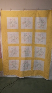 embroidered flowers quilt